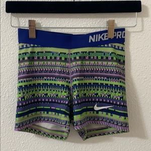 Green and prple Nike pro spandex shorts